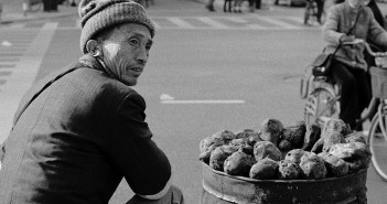 A_man_is_selling_some_sweet_potatoes