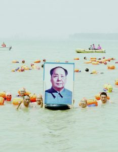 People Crossing the Yellow River with a Photo of Mao Zedong